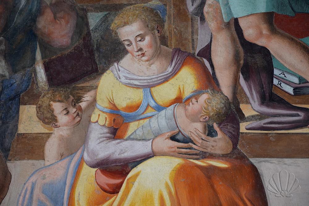 Siena, santa Maria della Scala: una balia ninna un orfanello